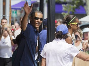 Obama and family wave to the crowd while vacationing on Martha's Vineyard